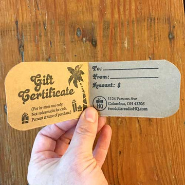 Two Dollar Radio Gift Certificate Cards in hand