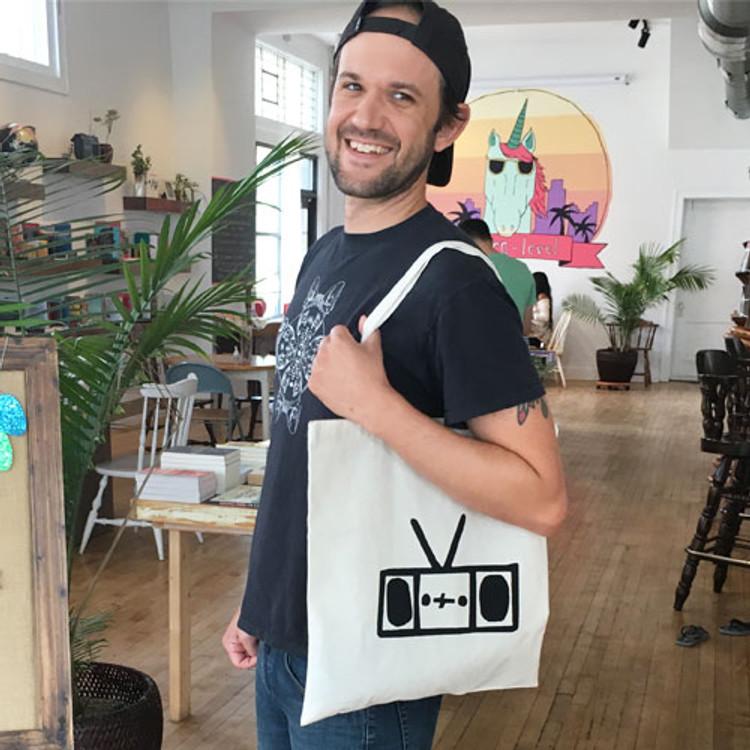 Two Dollar Radio Headquarters tote bag on Eric Obenauf