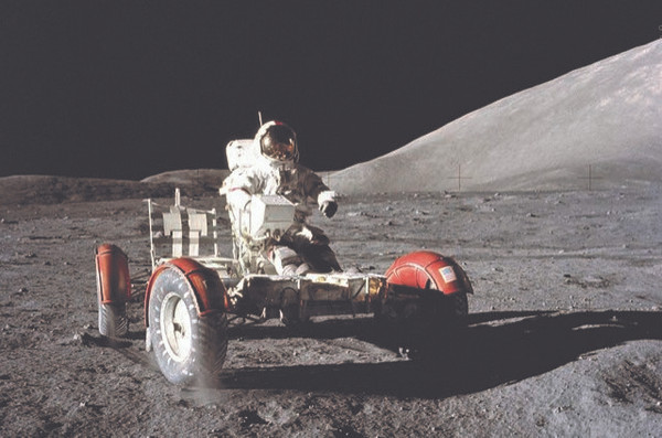 Astronaut Driving Rover Poster