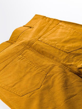 Close Up of Mens Gold Yellow Cord Jeans Rear Pockets