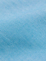 Close Up of Turquoise Short Sleeve Popover Shirt Fabric