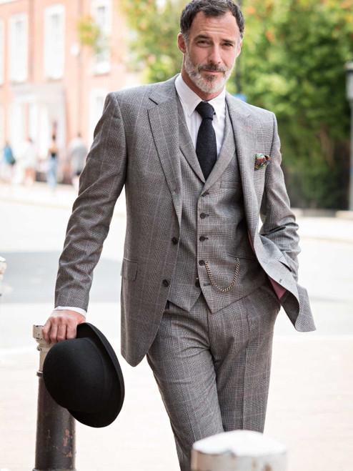 Model wearing Prince of Wales Luxury Merino Wool 3 Piece Suit