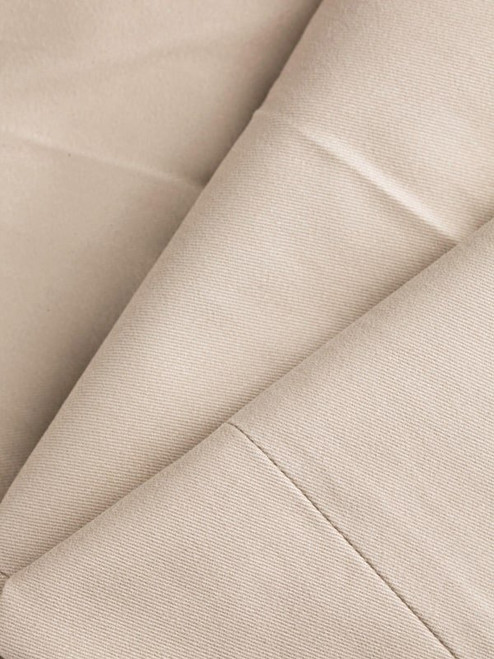Close Up of Mens Stone White Pleated Chinos Fabric