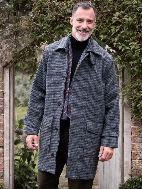 Model wears Gray Houndstooth Harris Tweed Overcoat
