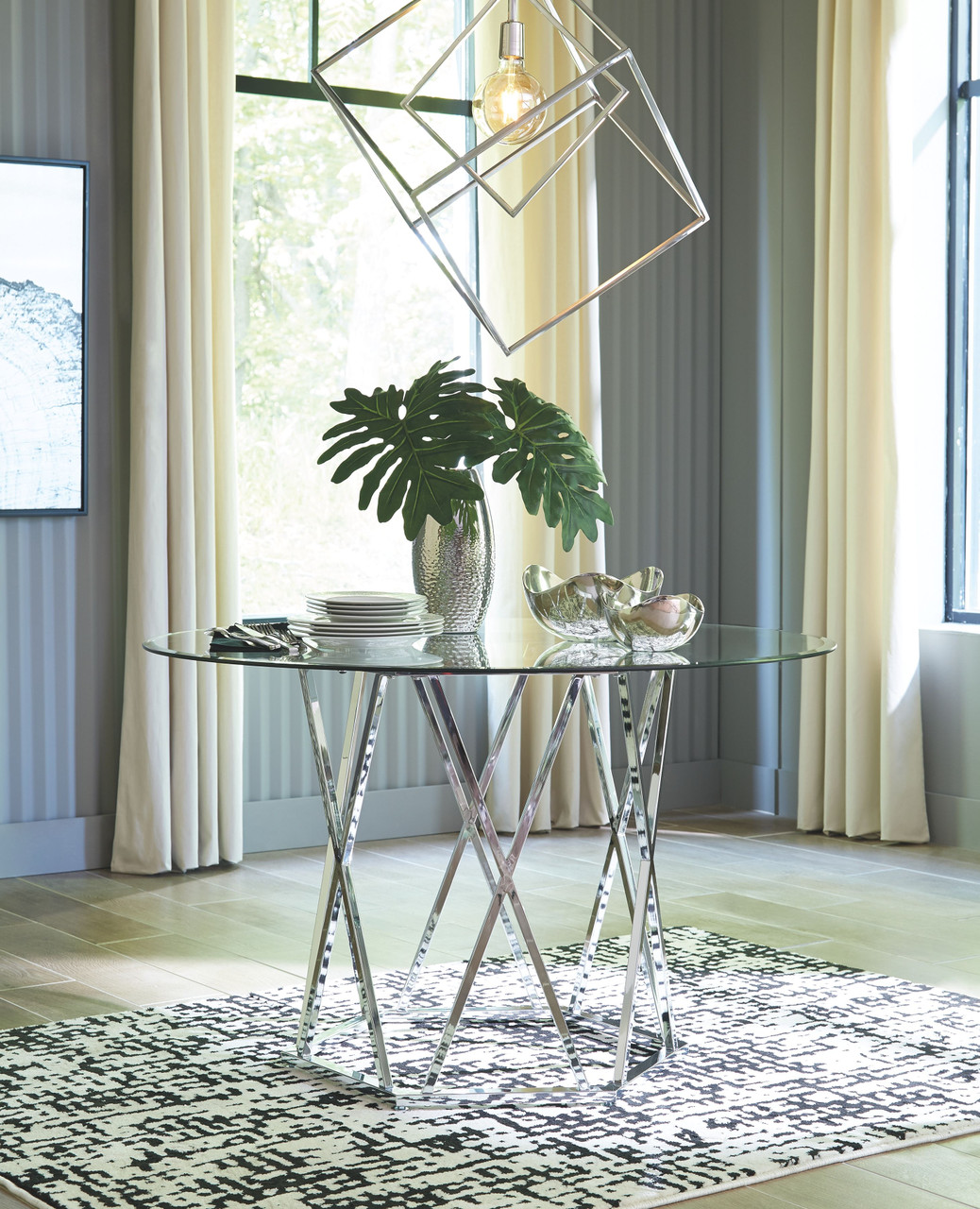 Madanere Chrome Finish Round Dining Room Table On Sale At Stringer Furniture Serving Jackson Ms