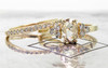 .79 carat oval, rose-cut prong set champagne diamond ring with six 2mm brilliant gray diamond clusters on either side of main setting set in 14k yellow gold flat band. With Wedding Band with 16 brilliant gray diamonds set in 14k yellow gold