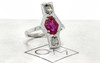 SANTORINI .49 carat cushion rose cut slat and pepper diamonds 1.24 carat rose cut ruby set in 14k white gold flat band. Part of New Classic Collection. 3/4 view on metal background with Chinchar/Maloney logo