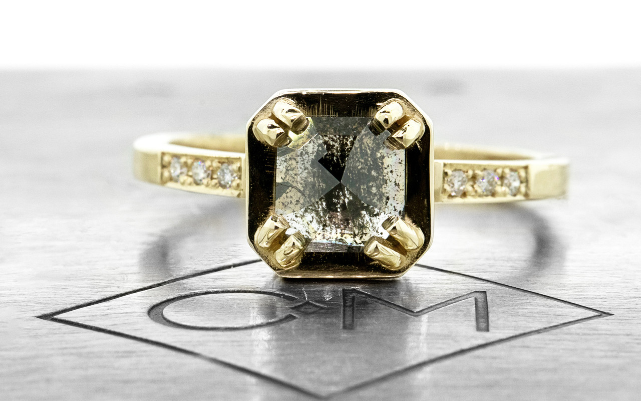 MAROA .93 carat rose-cut translucent salt and pepper diamond ring set in our signature square setting, set in 14k yellow gold. With ten 1.2mm brilliant white diamonds set in notched band and each corner of main setting. Part of our New Classic Collection. Front view on metal background with Chinchar/Maloney logo