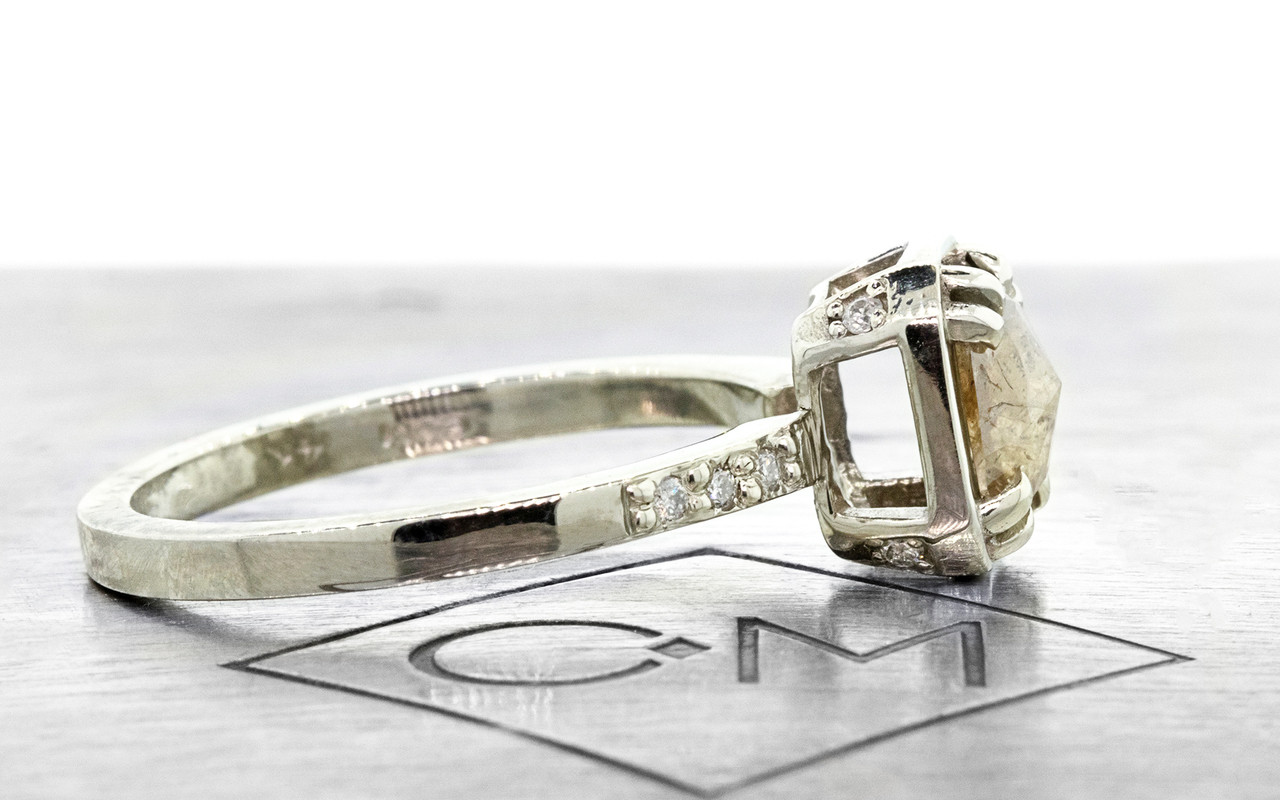 MAROA rectangular, rose-cut light gray diamond ring set in our signature square setting, set in 14k white gold. With ten 1.2mm brilliant white diamonds set in notched band and on each corner of main setting. Part of our New Classic Collection. Profile view on metal background with Chinchar/Maloney logo