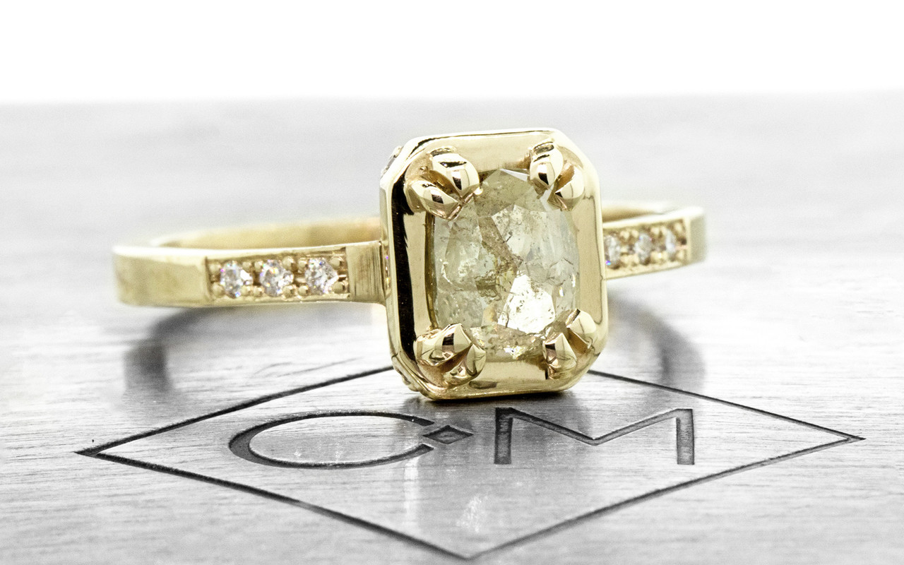 MAROA .71 carat rectangular, rose-cut translucent light champagne diamond ring set in our signature square setting, set in 14k yellow gold. With ten 1.2mm brilliant white diamonds set in notched band and each corner of main setting. Part of our New Classic Collection. 3/4 view on metal background with Chinchar/Maloney logo
