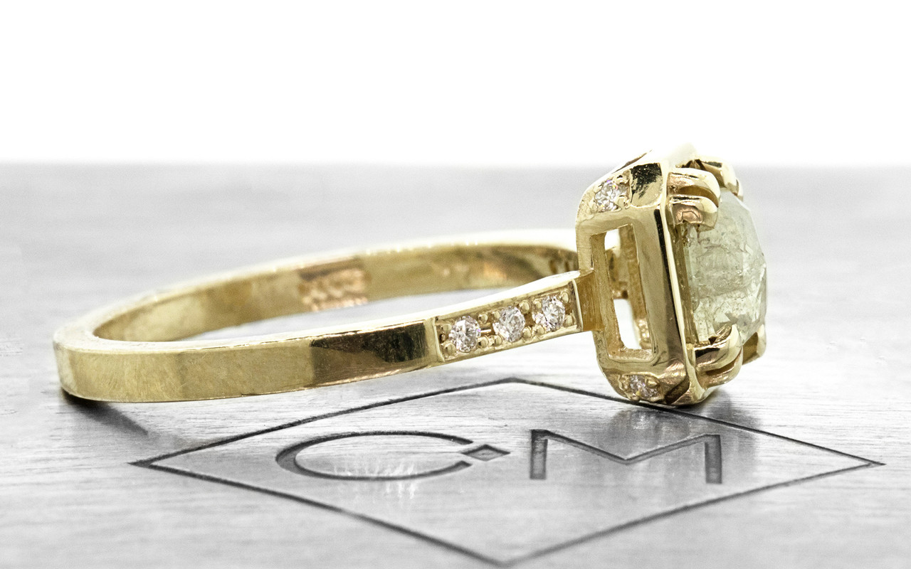 MAROA .71 carat rectangular, rose-cut translucent light champagne diamond ring set in our signature square setting, set in 14k yellow gold. With ten 1.2mm brilliant white diamonds set in notched band and each corner of main setting. Part of our New Classic Collection. Profile view on metal background with Chinchar/Maloney logo