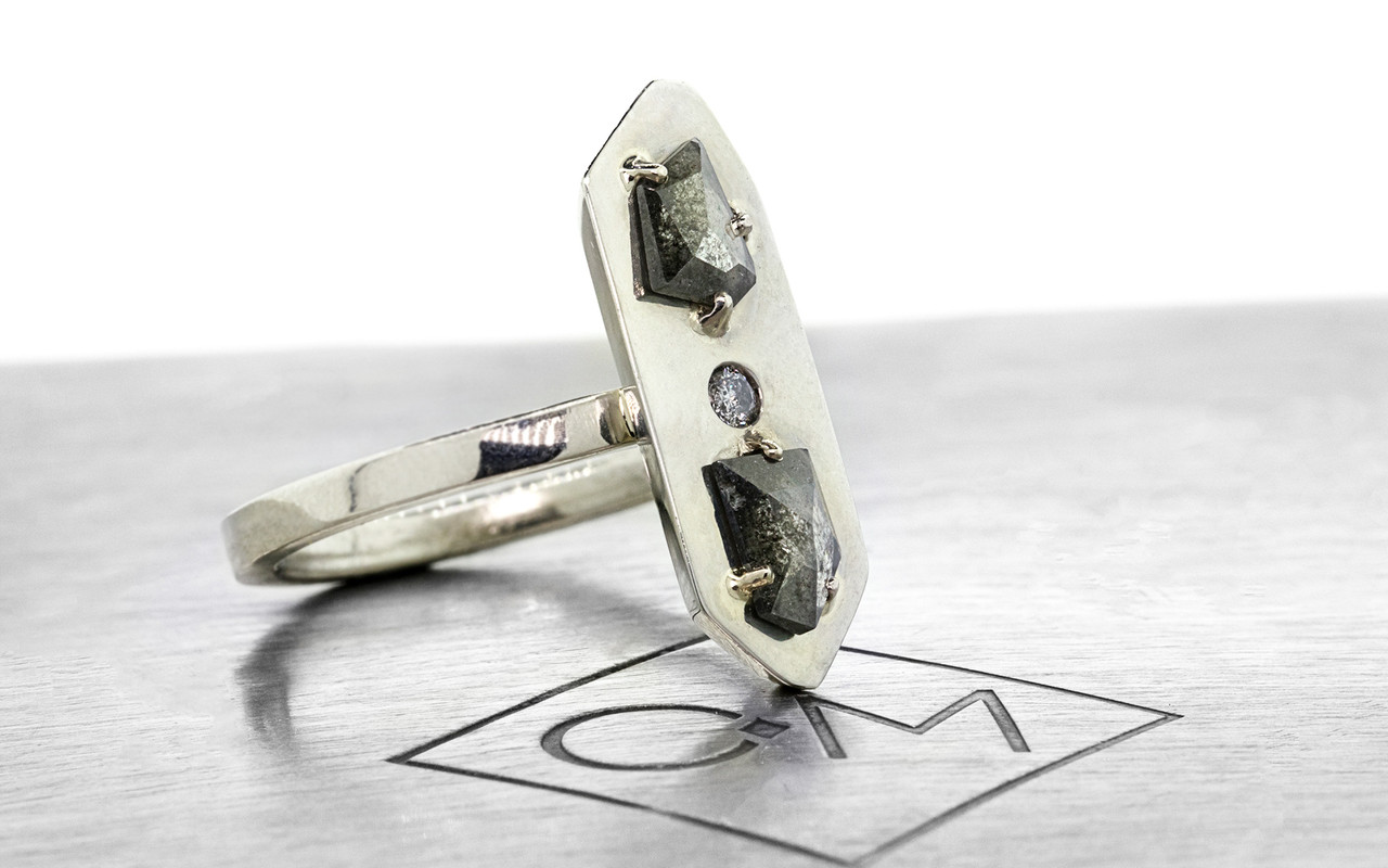 TOBA .57 carat fancy rose-cut translucent salt and pepper diamonds with one 2mm gray pave diamond set in 14k white gold flat band. Part of our New Classic Collection. 3/4 view on metal background with Chinchar/Maloney logo