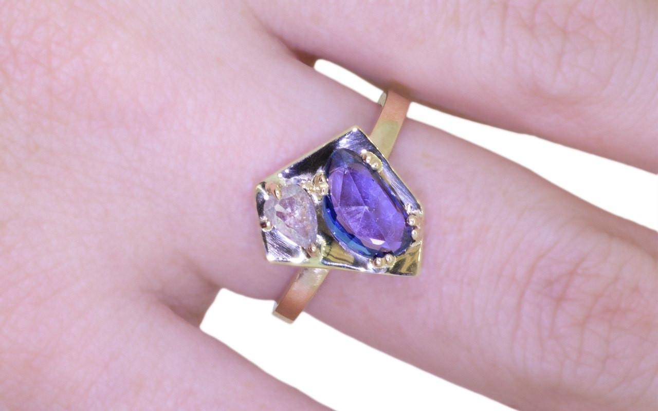 SANTORINI .50 carat icy white diamond 1.28 carat blue sapphire 14k yellow gold 2mm flat band on a hand