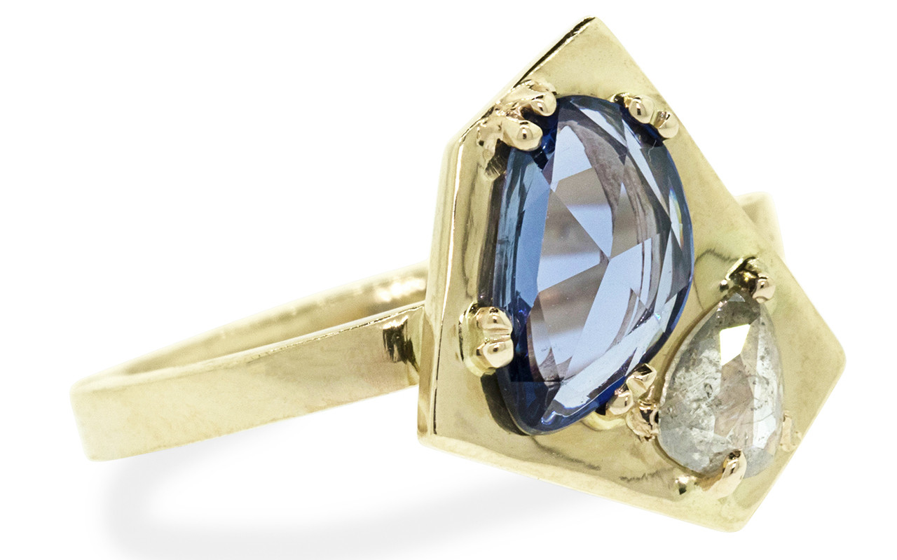 SANTORINI .50 carat icy white diamond 1.28 carat blue sapphire 14k yellow gold 2mm flat band front view on white background