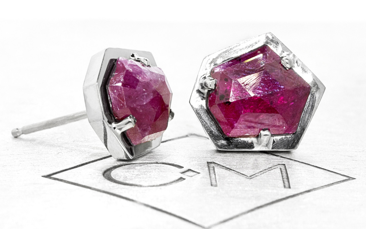 KIKAI 3.35 carat free form rose cut ruby stud earrings set in 14k white gold. Part of our New Classic Collection. 3/4 view and front view on metal background with Chinchar/Maloney logo