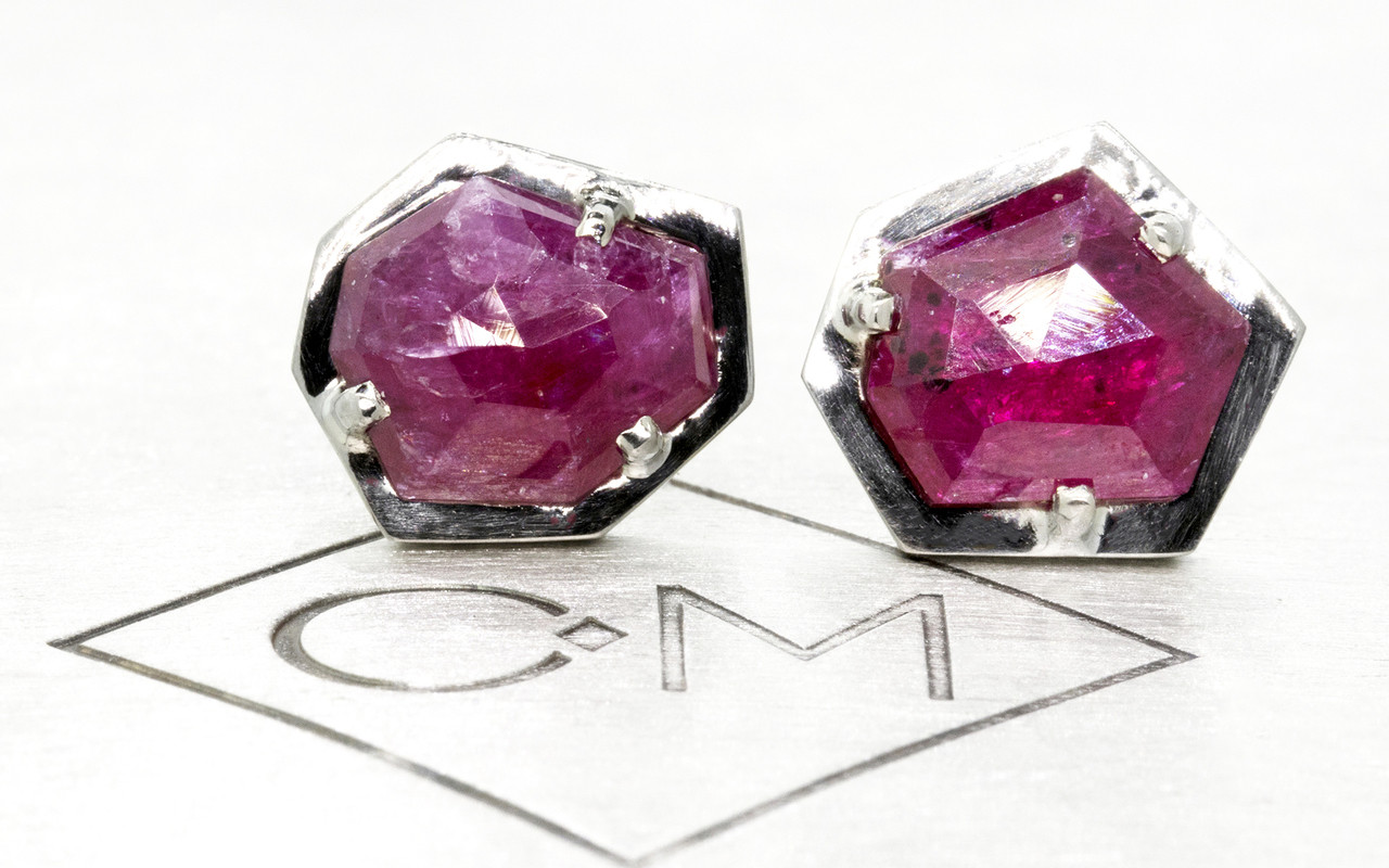 KIKAI 3.35 carat free form rose cut ruby stud earrings set in 14k white gold. Part of our New Classic Collection. Front view on metal background with Chinchar/Maloney logo