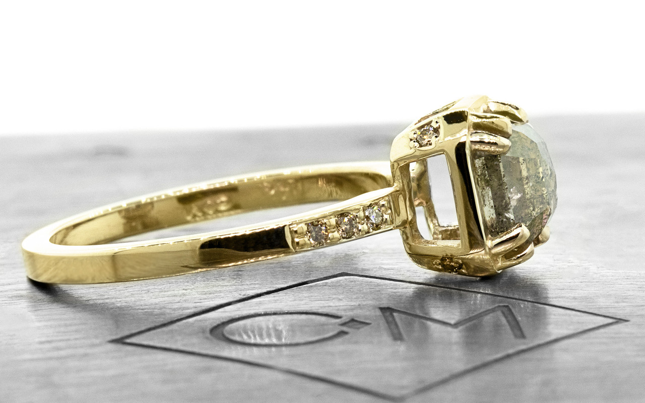 """MAROA one-of-a-kind, fancy-cut, 1.41 carat """"salt and pepper"""" diamond set in our New Classic setting. 1.2mm, brilliant champagne diamonds set into the 14k recycled yellow gold 2mm notched band. Part of our New Classic Collection. Side view on metal background with Chinchar/Maloney logo"""