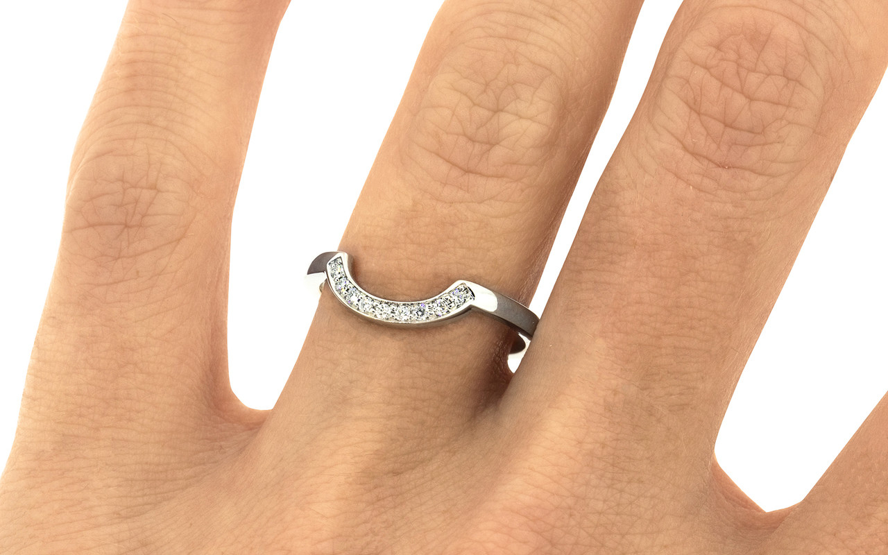 Our Curved Shadow Band features 10 brilliant white diamonds.  We can customize this ring with champagne or gray diamonds as well. band fits beautifully with many of our engagement rings and can also be customized. 14k recycled white gold this ring can also be made in 14k recycled yellow or rose gold. on a hand