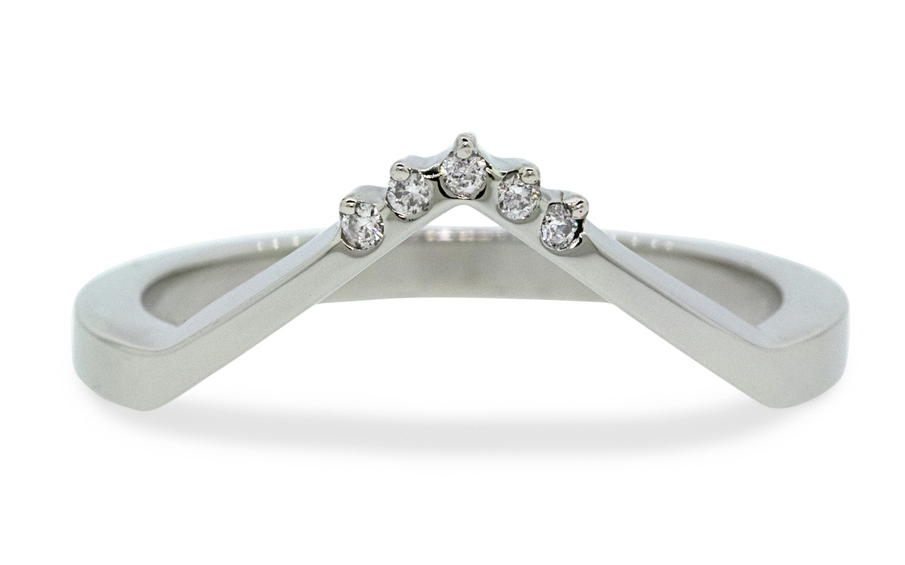V Shadow Band features 5 brilliant white diamonds.  We can customize this ring with champagne or gray diamonds as well. 14k recycled white gold this ring can also be made in 14k recycled yellow or rose gold. Can also be customized to fit a specific setting. Front view on white background.