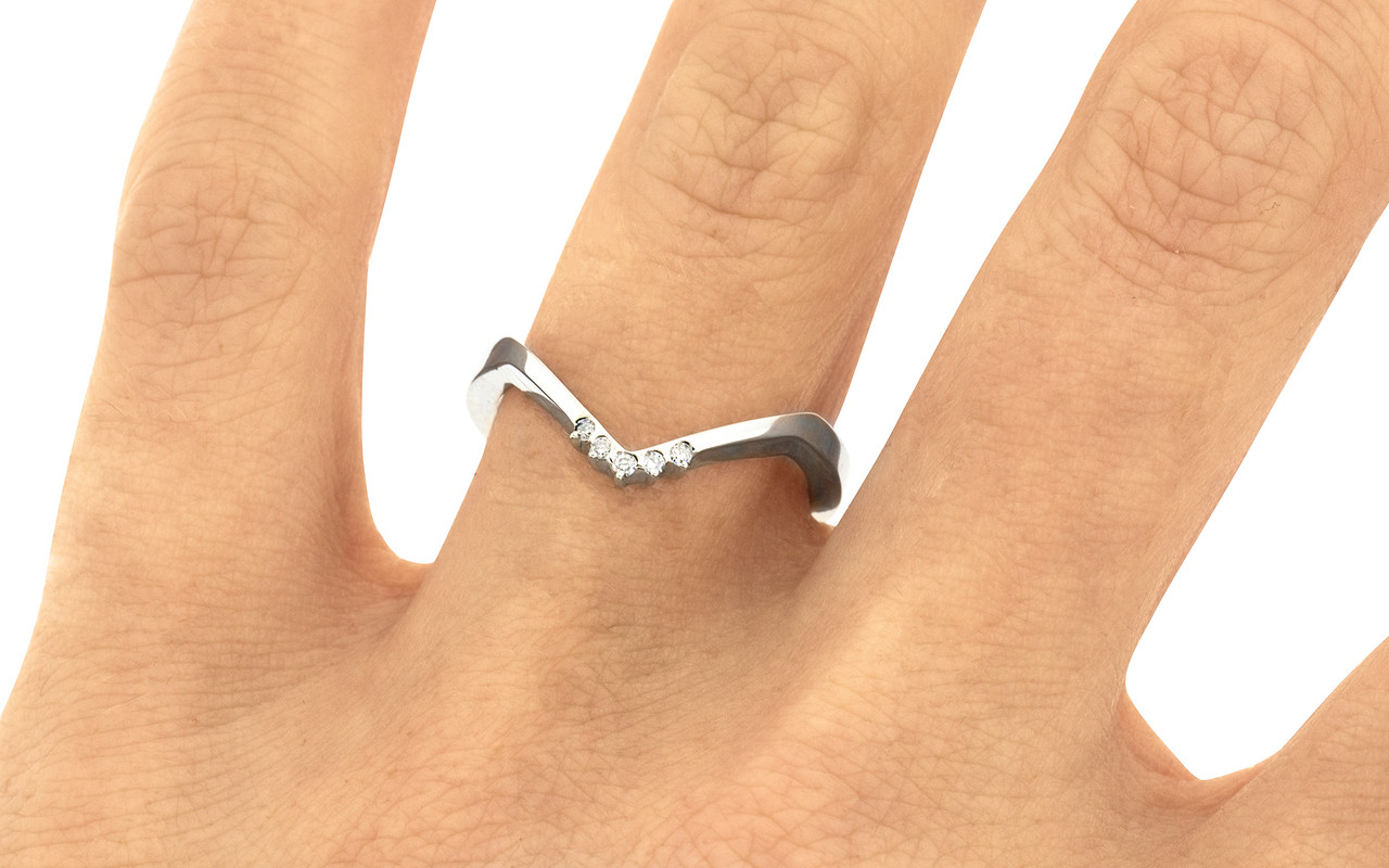 V Shadow Band features 5 brilliant white diamonds.  We can customize this ring with champagne or gray diamonds as well. 14k recycled white gold this ring can also be made in 14k recycled yellow or rose gold. Can also be customized to fit a specific setting. On a hand