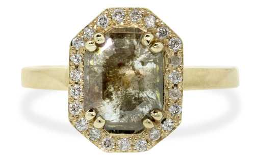 KATLA New Classic 1.17 carat fancy octagon cut smokey gray diamond prong set in octagon 14k yellow gold setting with brilliant, white diamonds surround the center diamond in a halo as well as each corner of the setting and each shoulder of the ring. Front view on white background