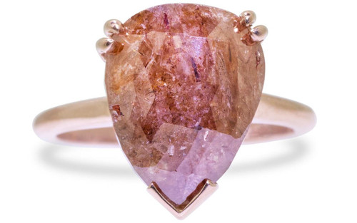 7.21 carat pear, rose cut natural rich cognac prong set diamond ring set in 14k rose gold 1/2 round band. Front view on white background