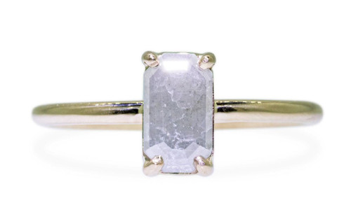 .58 carat fancy-cut gray prong set diamond ring set in 14k yellow gold 1/2 round band. Front view on white background