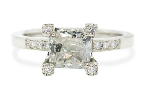 1.58 carat rectangle, faceted cut translucent salt and pepper diamond set in our CM original prong set diamond ring set in 14k white gold with six 1.2mm brilliant white diamonds set in flat band and tops of each prong. Front view on White background