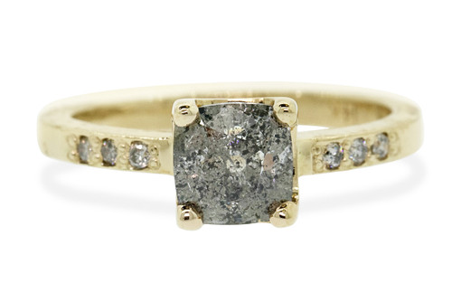 .93 carat cushion, faceted cut salt and pepper prong set diamond ring with six 1.2mm brilliant gray diamonds set in band set in 14k yellow gold flat band. Front view on white background