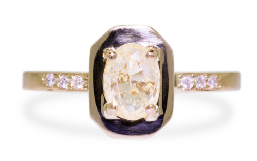 KIKAI .96 carat yellow oval, faceted cut sapphire with six 1.2mm brilliant white diamonds set in band. set in 14k yellow gold flat band. front view on white background  New Classic Collection