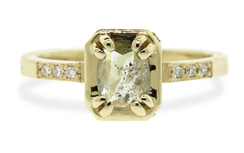 MAROA .53 carat rectangular, rose-cut translucent light champagne diamond set in our signature square setting, set in 14k yellow gold. With ten 1.2mm brilliant white diamonds set in notched band and each corner of main setting. Part of our New Classic Collection. Front view on white background