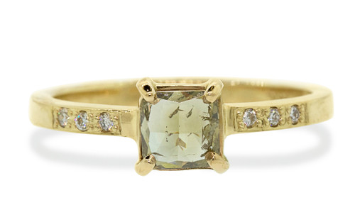 .75 carat cushion, faceted cut natural translucent champagne prong set diamond ring set in 14k yellow gold with six 1.2mm brilliant white diamonds set in flat band. With Deco Infinity Wedding Band with brilliant white diamonds set in 14k yellow gold on white background.