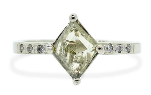 .83 carat fancy-cut light champagne prong set diamond ring with six 1.2mm brilliant gray diamonds set in 14k white gold flat band. Front view on white background