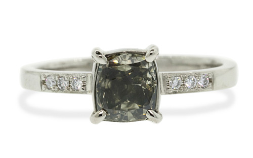 1.01 carat cushion, faceted cut dark champagne prong set diamond ring with six 1.2mm brilliant white diamonds set in band set in 14k white gold flat band. Front view on white background