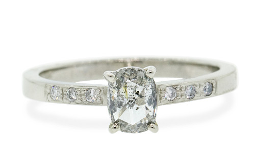 54 carat oval, rose cut translucent salt and pepper prong set diamond ring set in 14k white gold with six 1.2mm brilliant white diamonds set in band, flat band. Front view on white background