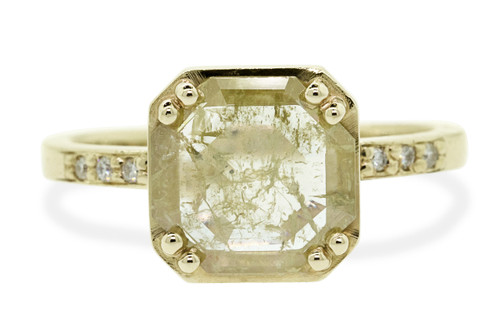 MAROA 1.21 carat fancy-cut rustic champagne and translucent white set in our signature CM square setting diamond ring set in 14k yellow gold. With ten 1.2mm brilliant white diamonds set in notched band and each corner of main setting. Part of our New Classic Collection. Front view on white background