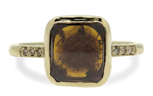 3.68 carat cushion, rose cut vivid cognac bezel set diamond ring set in 14k yellow gold with six 1.2mm brilliant champagne diamonds set in 1/2 round band. Front view on white background