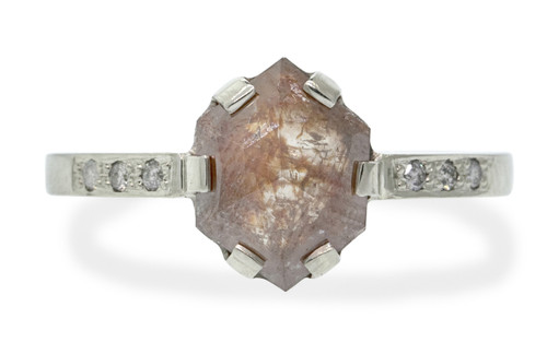 1.66 carat fancy, rose cut sunset peach prong set diamond ring set in 14k white gold with six 1.2mm brilliant gray diamonds set in flat band. Front view on white background with Chinchar/Maloney logo