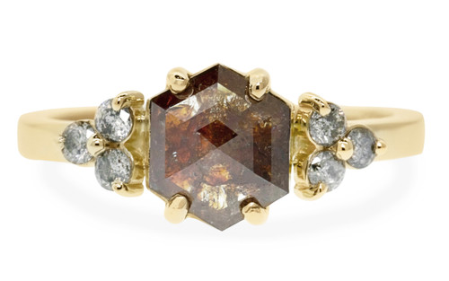 1 carat fancy, rose-cut rich cognac prong set diamond ring with six 2mm brilliant gray diamonds set in clusters on either side of main setting set in 14k yellow gold flat band. With Wedding Band with 16 brilliant gray diamonds set in 14k yellow gold on white background