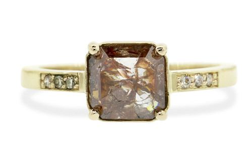 1.18 carat one of a kind cushion rose cut gorgeous, natural, rustic cognac prong set diamond ring. With six 1.2mm brilliant gray diamonds bead set into 14k recycled 2mm flat gold band. Front view on white background