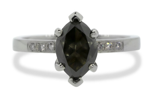One of a kind, this natural, translucent, black diamond weighs 1.53 carats. marquise, faceted cut prong set diamond. Set into 14k recycled white gold 2mm flat band with six 1.2mm brilliant gray diamonds bead set into band. Front view on white background