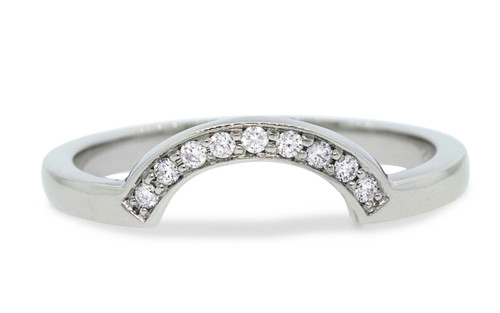 Our Curved Shadow Band features 10 brilliant white diamonds.  We can customize this ring with champagne or gray diamonds as well. band fits beautifully with many of our engagement rings and can also be customized. 14k recycled white gold this ring can also be made in 14k recycled yellow or rose gold. Front view on white background