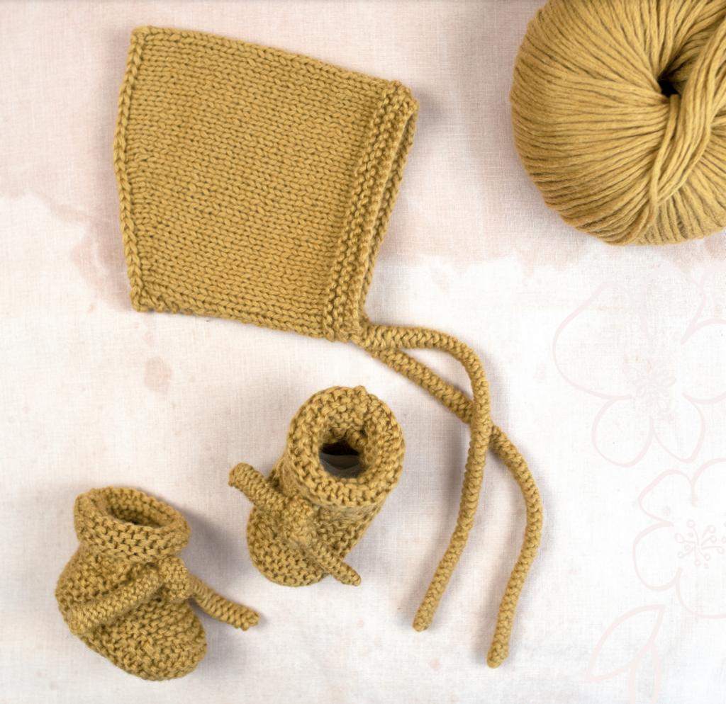 Junior Bootees & Peachy Bonnet in Rowan Cotton Wool - Main Image