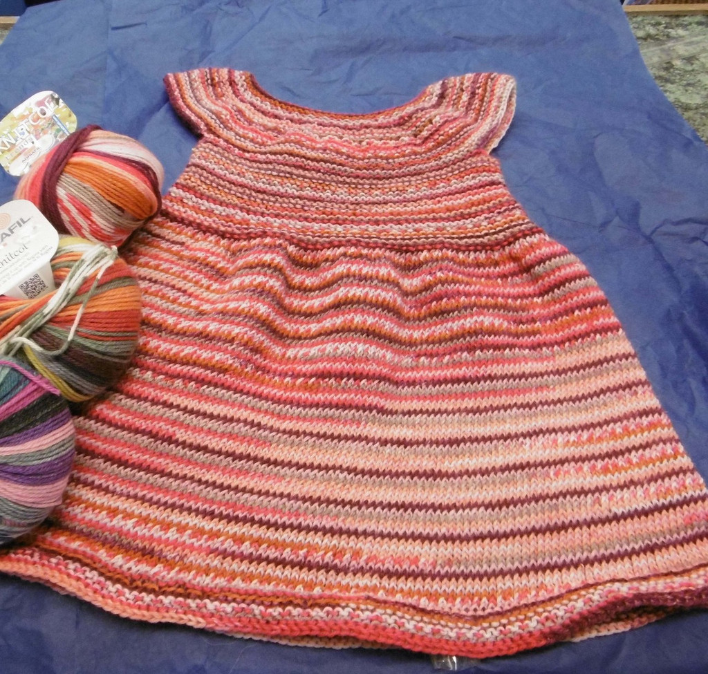 Childs dress knitted on circular needle using Adriafil Knitcol  DK