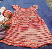 Baby & Childs Dress Knitting Pattern | Adriafil Knitcol 1548 - What it looks like knitted in a different colour