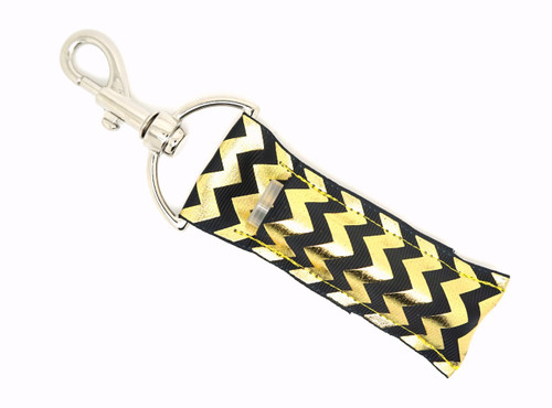 Black and Gold Foil Chevron lip balm holder   This lip balms holder is very durable with a stainless steel hook that is easily attached and unattached to a purse, keys, backpack, or lanyard.