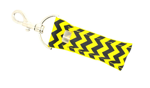 Black and Yellow Chevron lip balm holder   This lip balms holder is very durable with a stainless steel hook that is easily attached and unattached to a purse, keys, backpack, or lanyard.