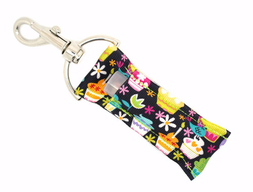 Cupcake black with flowers   This lip balms holder is very durable with a stainless steel hook that is easily attached and unattached to a purse, keys, backpack, or lanyard.