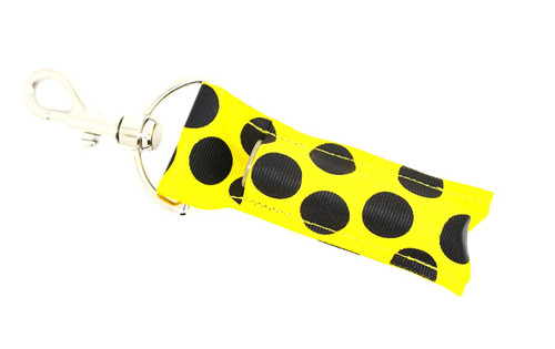 Yellow with Large Black Dots lip balm holder   This lip balms holder is very durable with a stainless steel hook that is easily attached and unattached to a purse, keys, backpack, or lanyard.  MADE IN THE USA!!