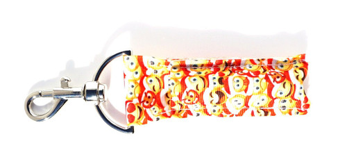 Christmas Emoji Lip balm Holder  This lip balms holder is very durable with a stainless steel hook that is easily attached and unattached to a purse, keys, backpack, or lanyard. This lip balm holder has multiple Christmas Emoji's faces .  MADE IN THE USA!!